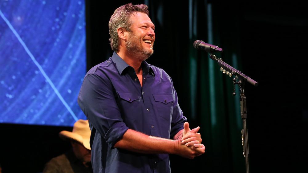 Blake Shelton smiling during a performance