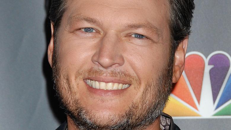 Blake Shelton poses with a smile.