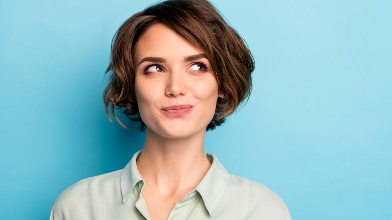 Woman smiling with bob haircut