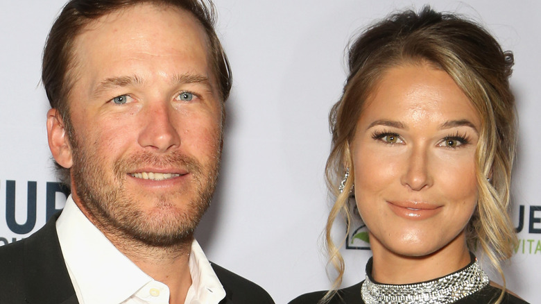 Bode Miller and Morgan Beck pose together and smile
