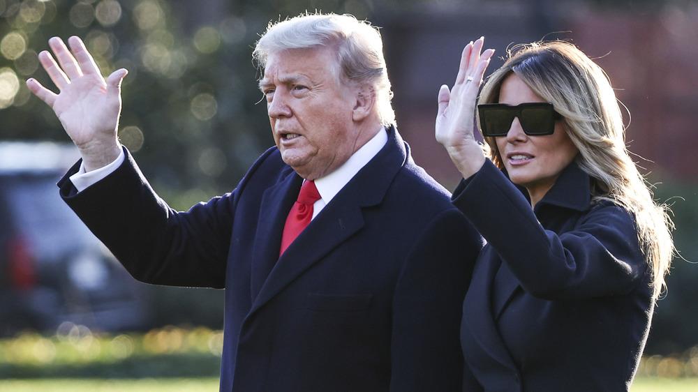 Melania Trump and Donald Trump waving
