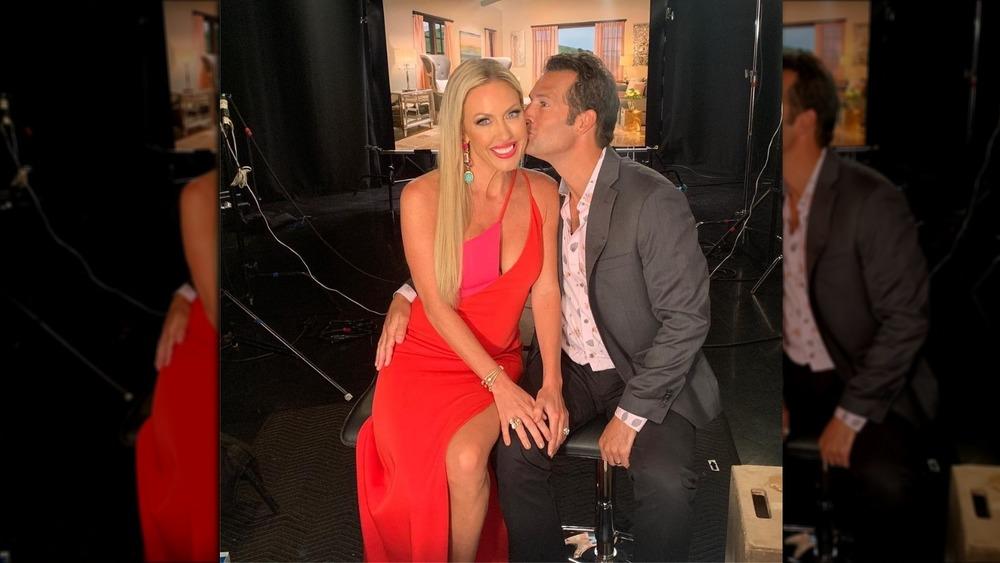 Braunwyn Windham-Burke's husband Sean kisses her on the cheek