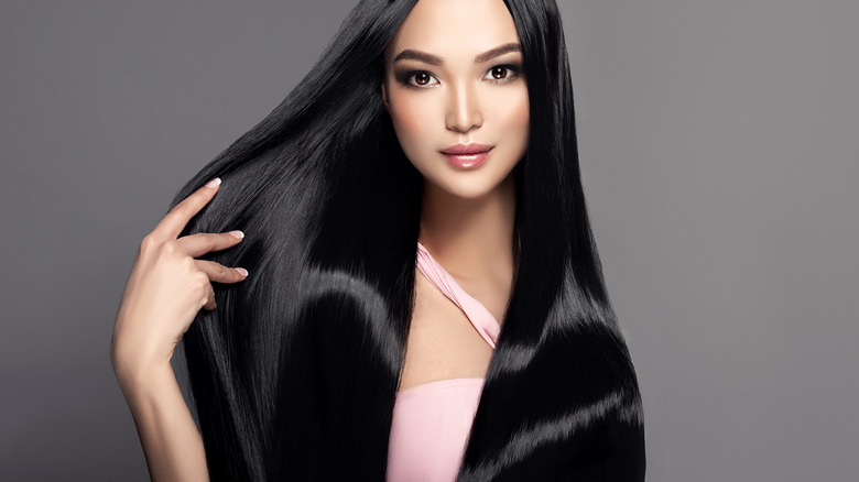 woman with sleek shiny hair