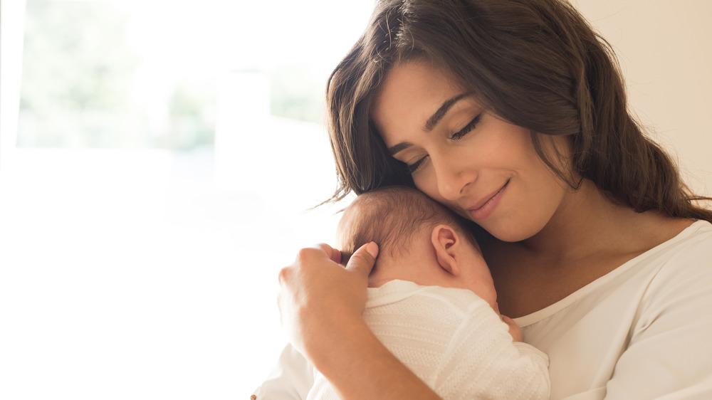 Woman hugs baby