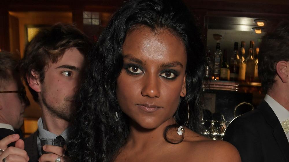 Simone Ashley looking at camera
