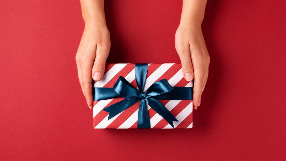 hands holding holiday gift