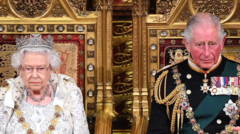 Queen Elizabeth and Prince Charles on thrones