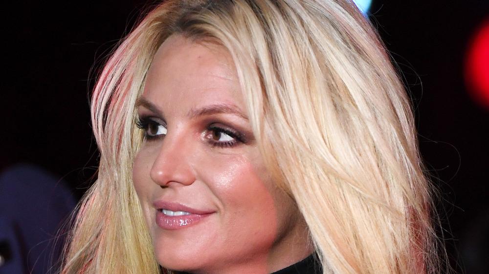 Britney Spears smiles in black dress