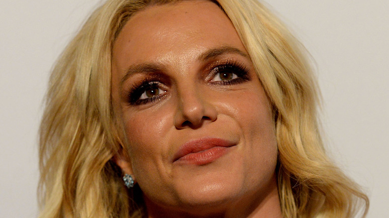 Singer Britney Spears walks the red carpet at the 2017 Pre-GRAMMY Gala And Salute to Industry Icons Honoring Debra Lee at The Beverly Hilton Hotel