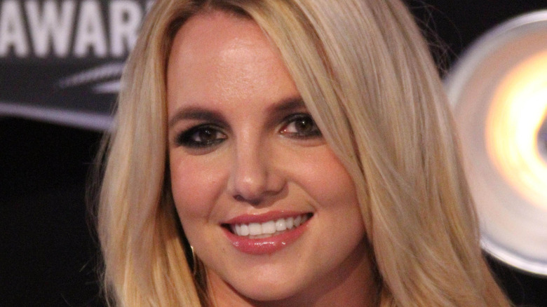 Britney Spears smiles for the camera at an event.