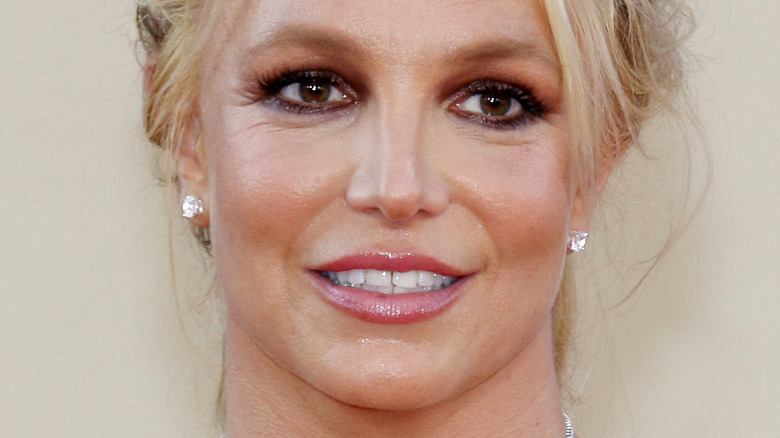 Britney Spears smiling and looking to the side