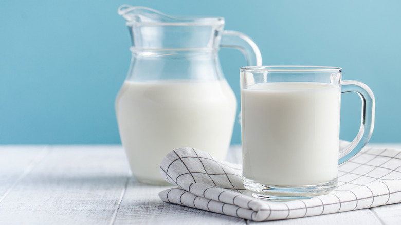 A jar and glass of milk