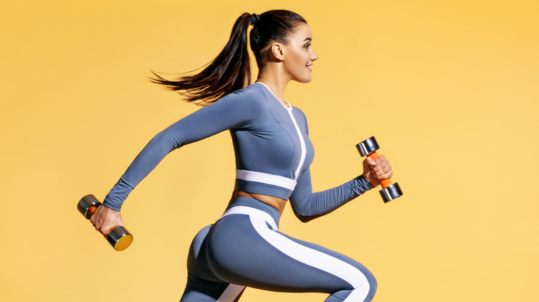 Woman doing cardio with weights