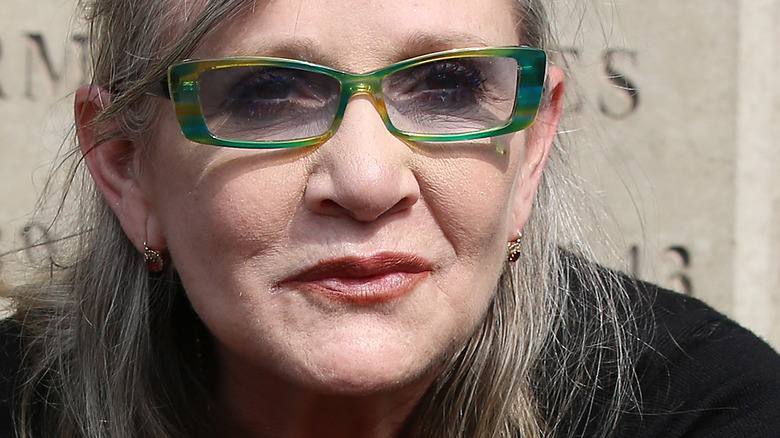 Carrie Fisher with green glasses