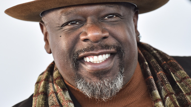 Cedric The Entertainer smiling at an event
