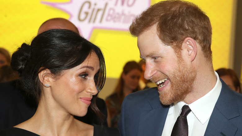 Prince Harry smiling at Meghan Markle
