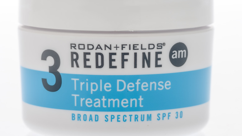 Close up of Rodan and Fields sunscreen on a white background.