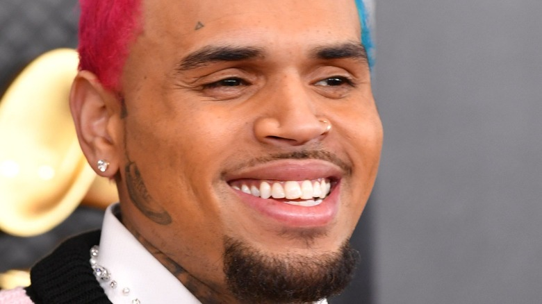 Chris Brown with red and blue hair and facial hair