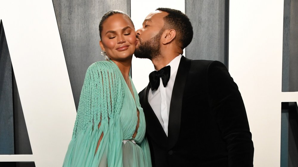 Chrissy Teigen and John Legend attend the 2020 Vanity Fair Oscar Party hosted by Radhika Jones at Wallis Annenberg Center for the Performing Arts on February 09, 2020 in Beverly Hills, California.