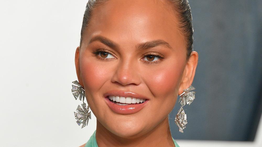 Chrissy Teigan with drop earrings