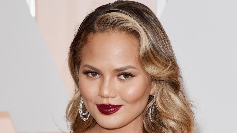 Chrissy Teigen wearing crimson lipstick