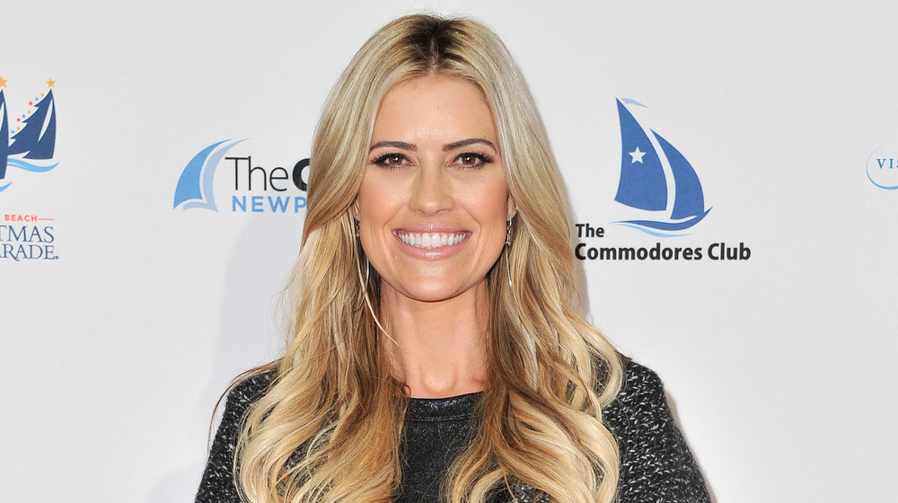 Christina Anstead poses at an event