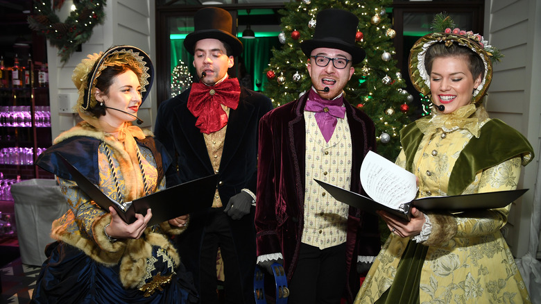 Christmas carolers in Victorian costume