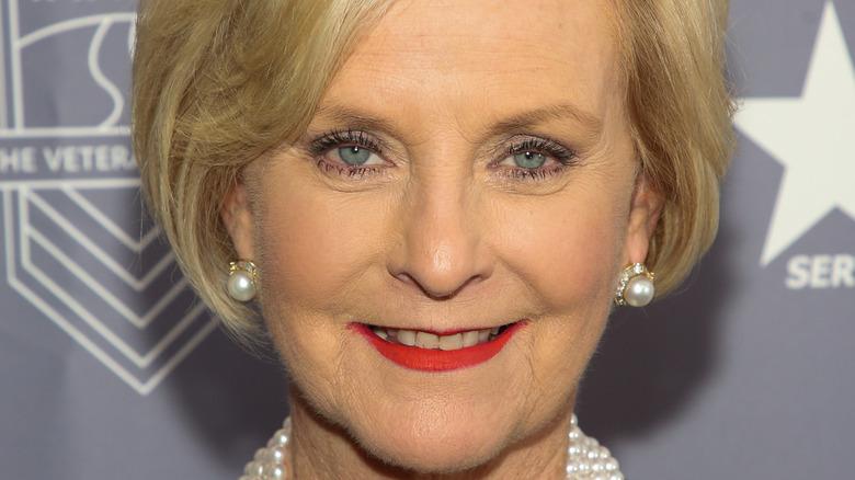 Cindy McCain smiling in pearl earrings