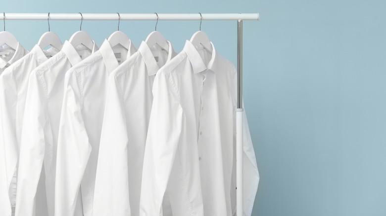 White shirts on clothing rack