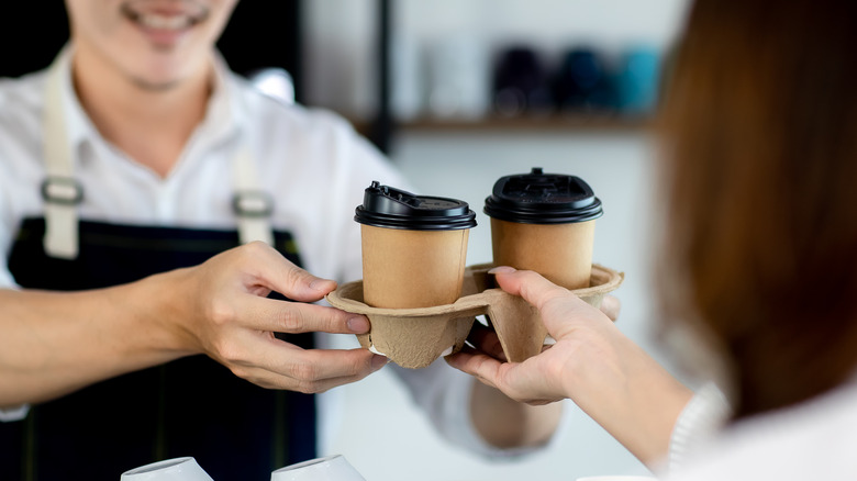 Person serving coffee