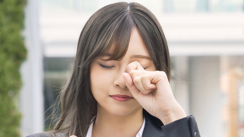 woman itching eyes