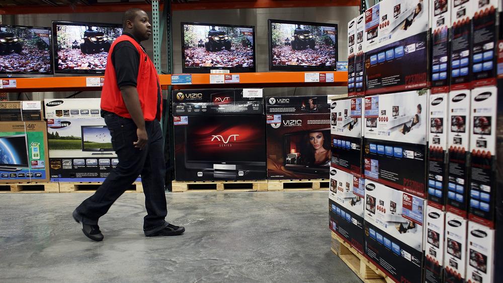 Costco employee walks floor