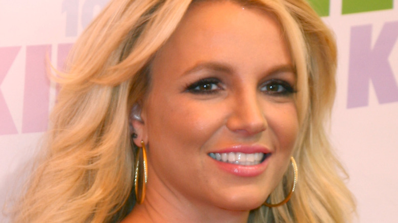 Britney Spears smiles on the red carpet.