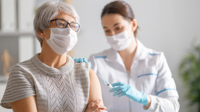 Woman getting vaccinated against COVID-19