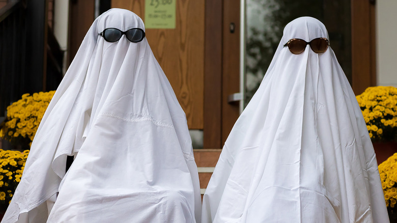 Couple dressed as ghosts