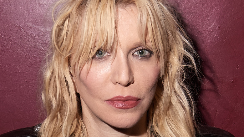 Courtney Love poses for a photo
