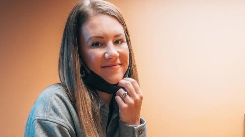 Danielle Busby in a gray sweatshirt