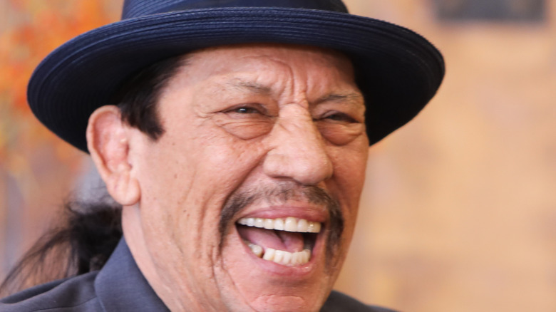 Actor Danny Trejo sporting a ponytail