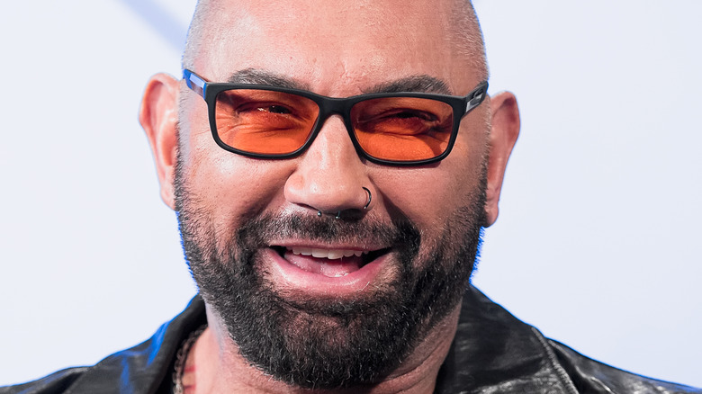 Dave Bautista laughs during a press conference
