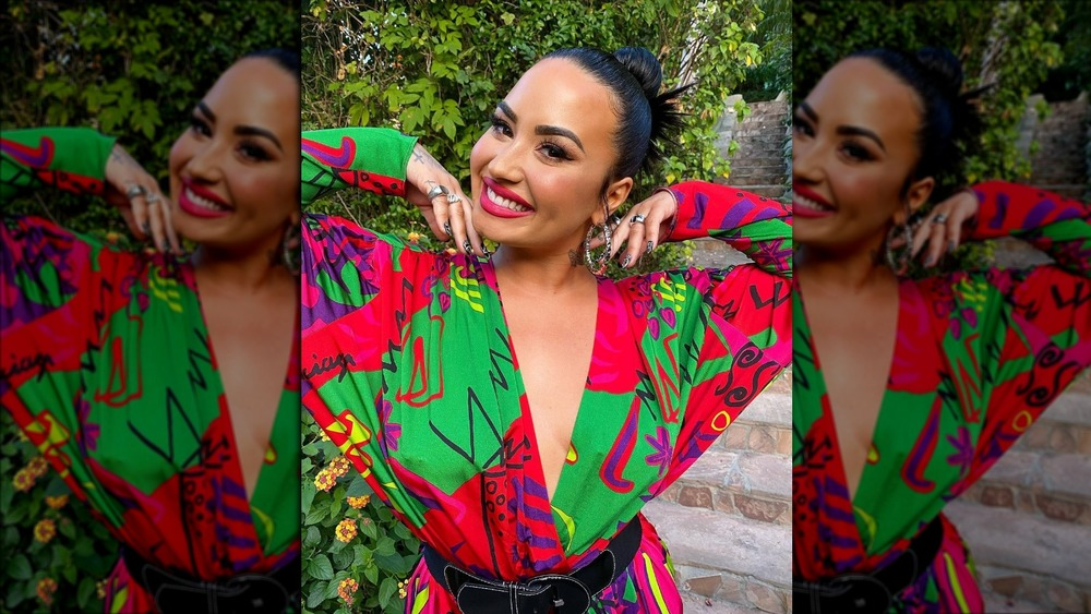 Demi Lovato all glammed up in a colorful dress