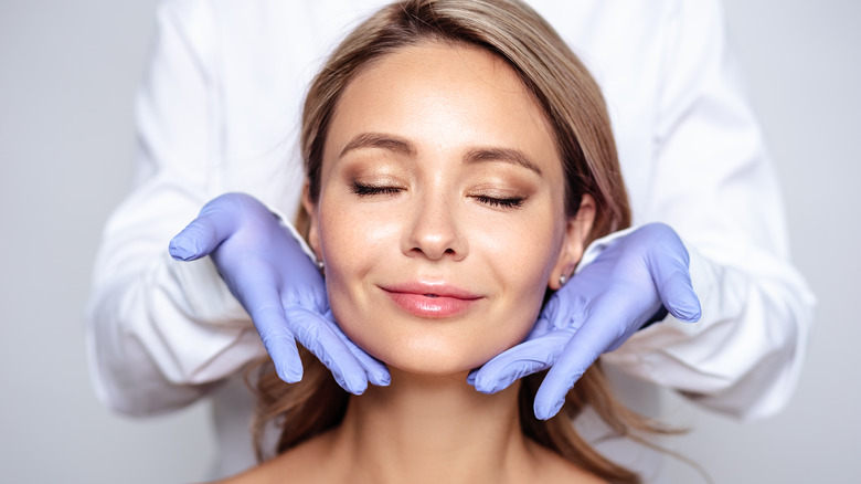 Young woman at the dermatologist