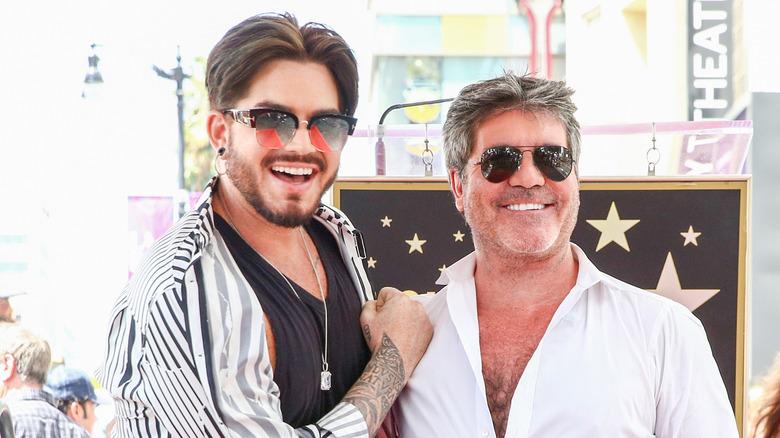 Adam Lambert posing with Simon Cowell
