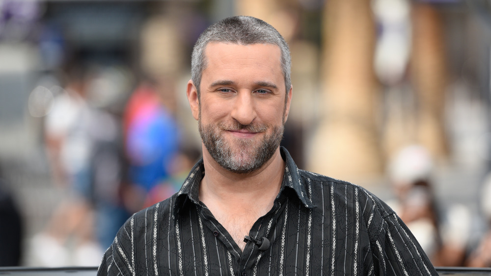 Dustin Diamond smiling at outdoor event