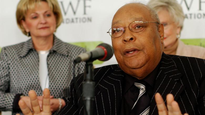Earl Woods in black suit