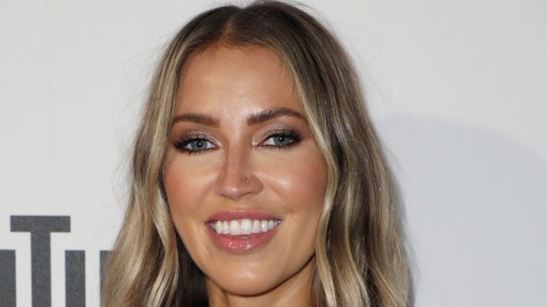 Kaitlyn Bristowe smiling at event