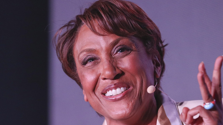 Robin Roberts on stage in a white suit