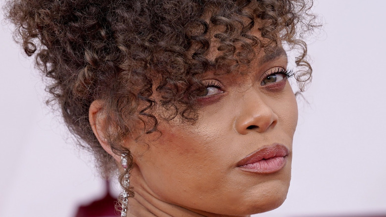 Andra Day posing on the red carpet