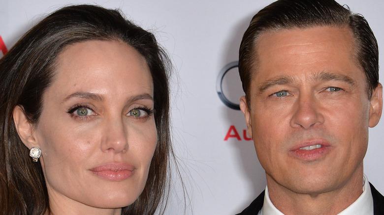 Angelina Jolie and Brad Pitt posing