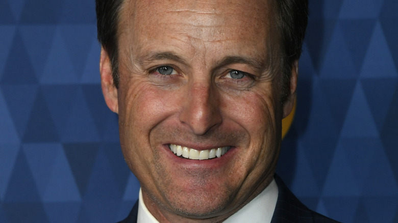 Chris Harrison poses at an event.
