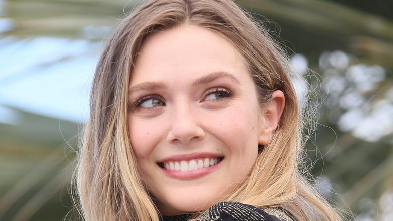 Elizabeth Olsen smiles at an event